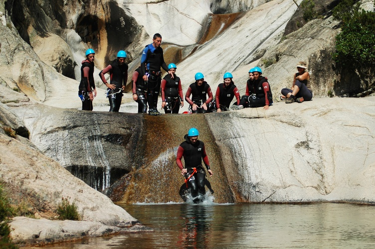 Purcaraccia, France - September 12, 2010: Extreme sports team participates in a canyoning contest on the famous waterfalls of Purcaraccia valley
